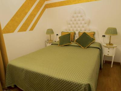 "Room n' 14 ""GIRASOLE"" moderate double room (The full size bed is 59.05in x 75in (150cm x 190 cm), recently renovated, at the first floor, has view overlooking a quite narrow street on the right side of our palace."